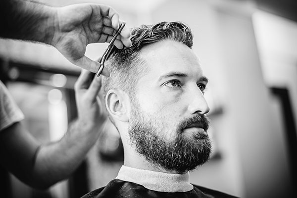Image of a man cutting his hair cut