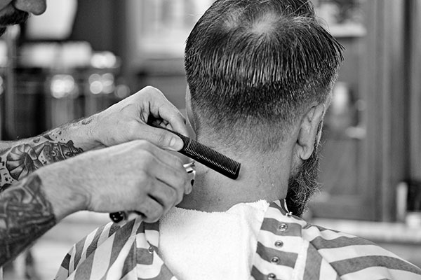Image of a man having a hair cut